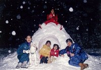 Princess Ayako is seen on the top of a snow hut as her family surrounds her at their residence in Tokyo's Minato Ward on Jan. 9, 1998. (Photo courtesy of the Imperial Household Agency)