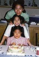 Princess Ayako, front, celebrates her 9th birthday with her older sisters at their residence in Tokyo's Minato Ward on Sept. 15, 1999. (Photo courtesy of the Imperial Household Agency)