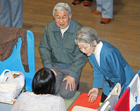 Emperor Akihito and Empress Michiko visit victims of the March 11, 2011 Great East Japan Earthquake, and the tsunami and nuclear disaster that ensued, for the first time on March 30, 2011 at Tokyo Budokan in Tokyo's Adachi Ward, which had been turned into an evacuation center. (Pool photo)