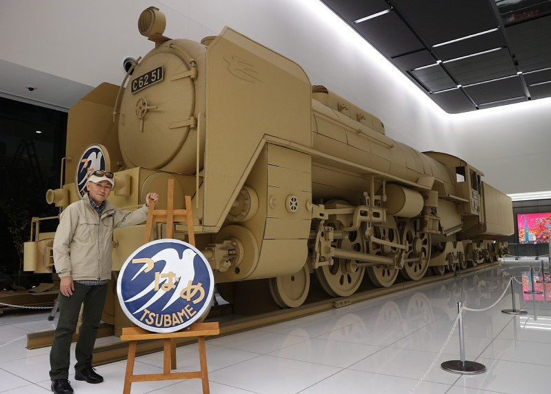 Full-scale cardboard steam locomotive model displayed in