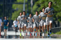 Runners hit the pavement around the Imperial Palace in Tokyo's Chiyoda Ward in this Aug. 9, 2017 file photo as a road mirage is seen because of intense heat. (Mainichi/Naoki Watanabe)
