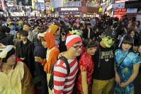Shibuya Center Street, a famous shopping arcade, is packed with people wearing Halloween attire, in Tokyo's Shibuya Ward on Oct. 31, 2018. (Mainichi/Daisuke Wada)