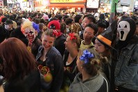 People dressed in Halloween costumes gather at Shibuya Center Street, a famous shopping arcade, in Tokyo's Shibuya Ward on Oct. 31, 2018. (Mainichi/Daisuke Wada)
