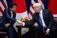 President Donald Trump shakes hands with Japanese Prime Minister Shinzo Abe at the Lotte New York Palace hotel during the United Nations General Assembly, Wednesday, Sept. 26, 2018, in New York. (AP Photo/Evan Vucci)