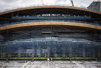 The main wooden roof section for the Olympic Gymnastic Centre for the Tokyo 2020 Olympic and Paralympic Games is seen in Tokyo, on Nov. 7, 2018. (AP Photo/Eugene Hoshiko)