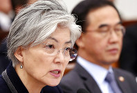 South Korean Foreign Minister Kang Kyung-wha answers a lawmaker's question as Unification Minister Cho Myoung-gyon, right, sits at the National Assembly in Seoul, South Korea, on Nov. 8, 2018. (Kim Ju-hyung/Yonhap via AP)