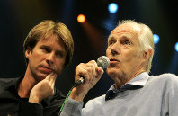 In this May 24, 2006 file photo, Giles Martin, left, listens as his father, original Beatles producer George Martin speaks after a sneak preview of a new Beatles-themed Cirque du Soleil show,