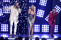 In this April 15, 2018 file photo, Tyler Hubbard, right, and Brian Kelley, left, of Florida Georgia Line, and Bebe Rexha, center, perform