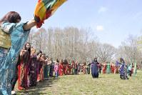 Kurdish women dance in traditional dress during the ethnic