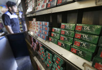 This May 17, 2018 photo shows packs of Kool menthol cigarettes displayed with other tobacco products at Ted's Market in San Francisco. (AP Photo/Jeff Chiu)