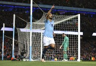 Manchester City's Ilkay Gundogan celebrates after scoring his side's third goal during the English Premier League soccer match between Manchester City and Manchester United at the Etihad stadium in Manchester, England, on Nov. 11, 2018. (AP Photo/Dave Thompson)