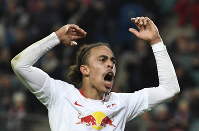 Leipzig's Yussuf Poulsen celebrates after scoring his side's third goal during the German first division Bundesliga soccer match between RB Leipzig and Bayer 04 Leverkusen in Leipzig, Germany, on Nov. 11, 2018. (AP Photo/Jens Meyer)