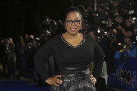In this March 13, 2018 file photo, actress Oprah Winfrey poses for photographers upon arrival at the premiere of the film 'A Wrinkle In Time' in London. (Photo by Joel C Ryan/Invision/AP)