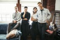 In this Sept. 28, 2018 photo, members of Mumford & Sons, from left, Ben Lovett, Marcus Mumford, Winston Marshall and Ted Dwane pose for a portrait in New York to promote their fourth album