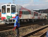 Sanriku Railway Co.'s new train cars are transported into the Kuji rail yard in the Iwate Prefecture city of Kuji, after arriving at JR Kuji Station, on Nov. 13, 2018. (Mainichi/Ayumi Kanuka)