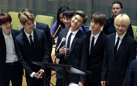 In this Sept. 24, 2018, file photo, members of the Korean K-Pop group BTS attend a meeting at the United Nations high level event regarding youth during the 73rd session of the United Nations General Assembly at U.N. headquarters. (AP Photo/Craig Ruttle)