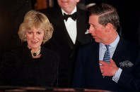 In this Jan. 28, 1999 file photo, Britain's Prince Charles and his companion Camilla Parker Bowles leave the Ritz Hotel in London, the first time that the couple, who have been friends for more than 25 years, have appeared together in public.  (AP Photo/Alastair Grant)