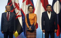 ASEAN Leaders pose for a family photo during the opening ceremony for the 33rd ASEAN Summit and Related Summits on Nov. 13, 2018, in Singapore. From left; Prime Minister Mahathir Mohamad of Malaysia, Myanmar Leader Aung San Suu Kyi, President Rodrigo Duterte of The Philippines. (AP Photo/Bullit Marquez)
