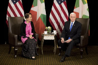 U.S. Vice President Mike Pence, right, meets Myanmar leader Aung San Suu Kyi in Singapore, on Nov. 14, 2018. (AP Photo/Bernat Armangue, Pool)
