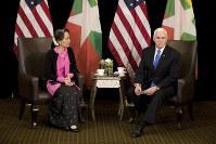 U.S. Vice President Mike Pence, right, meets Myanmar leader Aung San Suu Kyi in Singapore, on Nov. 14, 2018. (AP Photo/Bernat Armangue, Pool)