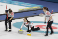 In this Feb. 25, 2018 file photo, Kim Eun-jung of South Korea, throws during her team's women's curling final in the Gangneung Curling Centre at the 2018 Winter Olympics in Gangneung, South Korea. (AP Photo/Natacha Pisarenko)