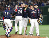 All Japan's first baseman Hotaka Yamakawa, second from right, celebrates with teammates after beating Major League's team 12-6 in Game 2 of their All-Stars Series baseball at Tokyo Dome in Tokyo, on Nov. 10, 2018. (AP Photo/Toru Takahashi)