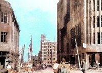 The Fukuya department store, right, is painted black with tar in a bid to avoid air raids, while the building of the Chugoku Shimbun stands in the back in this photo taken on Aug. 9, 1945, colorized with artificial intelligence. This point was about 800 meters from the epicenter of the atomic explosion. (Mainichi/Yukio Kunihira)