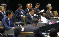 Japanese Prime Minister Shinzo Abe, left, Chinese Premier Li Keqiang, center, and South Korean Foreign Minister Kang Kyung-wha, right, who represented South Korean President Moon Jae-in, prepare to deliver their respective statements at the ASEAN Plus Three Summit in the ongoing 33rd ASEAN Summit and Related Summits in Singapore, on Nov. 15, 2018. (AP Photo/Bullit Marquez)