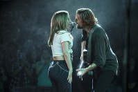 This image released by Warner Bros. Pictures shows Lady Gaga, left, and Bradley Cooper in a scene from