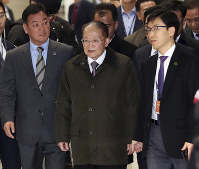North Korean vice chairman of the Korea Asia-Pacific Peace Committee Ri Jong Hyok, center, arrives at the Incheon International Airport in Incheon, South Korea, on Nov. 14, 2018. (Kim In-chul/Yonhap via AP)