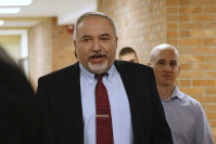 Israeli Defense Minister Avigdor Lieberman, center, arrives to the Knesset, Israel's Parliament, in Jerusalem, on Nov. 14, 2018. (AP Photo/Ariel Schalit)