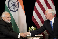 U.S. Vice President Mike Pence, right, meets India Prime Minister Narendra Modi in Singapore, on Nov. 14, 2018. (AP Photo/Bernat Armangue)