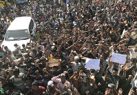 Rohingya refugees shout slogans against repatriation at Unchiprang refugee camp near Cox's Bazar in Bangladesh, on Nov. 15, 2018. (AP Photo/Dar Yasin)