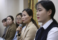 Kim Eun-jung, second from right, a member of South Korean Olympic women's curling team, speaks during a press conference in Seoul, South Korea, on Nov. 15, 2018. (AP Photo/Ahn Young-joon)