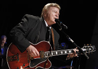 In this May 17, 2009, file photo, country music star Roy Clark performs after being inducted into the Country Music Hall of Fame in Nashville, Tenn. (AP Photo/Mark Humphrey)