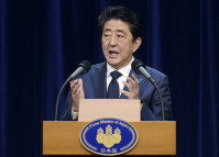 Japanese Prime Minister Shinzo Abe addresses the media during a press conference in Darwin, Australia, on Nov. 16, 2018. Michael Franchi/Pool Photo via AP)