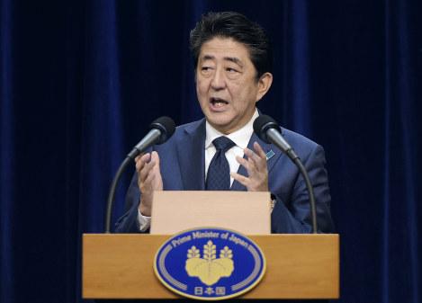 Japanese Prime Minister Shinzo Abe addresses the media during a press conference in Darwin, Australia, on Nov. 16, 2018. Michael Franchi/Pool Photo via AP)