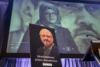 In this Nov. 2, 2018 file photo, a video image of Hatice Cengiz, fiancee of slain Saudi journalist Jamal Khashoggi, is played during an event to remember Khashoggi, who was killed inside the Saudi Consulate in Istanbul on Oct. 2, in Washington. (AP Photo/J. Scott Applewhite)