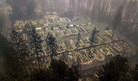 Residences leveled by the wildfire line a neighborhood in Paradise, Calif., on Nov. 15, 2018. (AP Photo/Noah Berger)