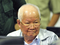 In this photo released by the Extraordinary Chambers in the Courts of Cambodia, Khieu Samphan, former Khmer Rouge head of state, sits in a court room before a hearing at the U.N.-backed war crimes tribunal in Phnom Penh, Cambodia, on Nov. 16, 2018. (Mark Peters/Extraordinary Chambers in the Courts of Cambodia via AP)
