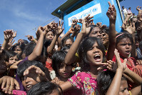 Rohingya refugee children shout slogans during a protest against the repatriation process at Unchiprang refugee camp near Cox's Bazar in Bangladesh, on Nov. 15, 2018. (AP Photo/Dar Yasin)