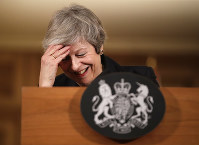Britain's Prime Minister Theresa May reacts during a press conference inside 10 Downing Street in London, on Nov. 15, 2018. (AP Photo/Matt Dunham, Pool)