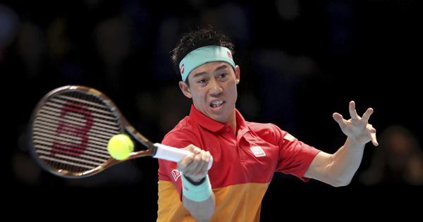 Japan's Kei Nishikori returns a shot to Austria's Dominic Thiem, during the ATP World Tour Finals men's singles tennis match at the O2 arena in London, on Nov. 15, 2018. (John Walton/PA via AP)