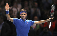 Switzerland's Roger Federer celebrates winning his ATP World Tour Finals men's singles tennis match against South Africa's Kevin Anderson at the O2 arena in London, on Nov. 15, 2018. (John Walton/PA via AP)