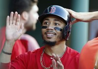 In this July 13, 2018 file photo,Boston Red Sox's Mookie Betts celebrates after scoring on a single by Brock Holt during the second inning of a baseball game against the Toronto Blue Jays in Boston. (AP Photo/Michael Dwyer)