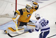 Pittsburgh Penguins goaltender Matt Murray (30) makes a glove save during the first period of the team's NHL hockey game against the Tampa Bay Lightning in Pittsburgh, on Nov. 15, 2018. (AP Photo/Gene J. Puskar)