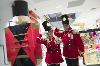 In this Nov. 13, 2018 photo, FAO Schwarz toy soldiers dressed in uniforms designed by model Gigi Hadid pose for a photo during a media preview of the new FAO Schwarz store at Rockefeller Center in New York. (AP Photo/Mary Altaffer)