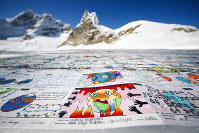 A giant postcard of approximately 2,500 square meters made of contributions from over 125,000 individual postcards containing messages aiming to fight climate change and global warming, is pictured on the Aletsch glacier near the Jungfraujoch saddle by the Jungfrau peak, in Switzerland, on November 16, 2018. (Valentin Flauraud/Keystone via AP)