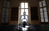 In this photo taken on Oct. 17, 2018, a replica of the International Prototype Kilogram is pictured at the International Bureau of Weights and Measures, in Sevres, near Paris. (AP Photo/Christophe Ena)