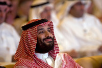 Saudi Crown Prince Mohammed bin Salman smiles as he attends the Future Investment Initiative conference, in Riyadh, Saudi Arabia, on Oct. 23, 2018. (AP Photo/Amr Nabil)
